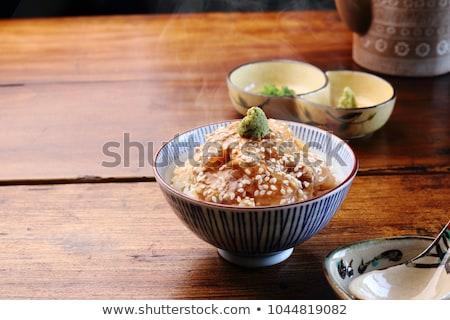 çanak pişmiş pirinç yeşil soğan turuncu mavi Stok fotoğraf © Melnyk