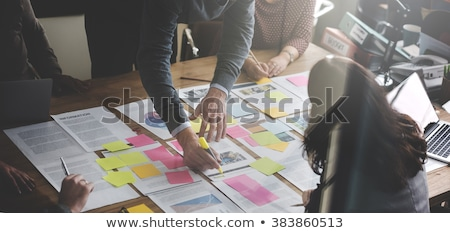 businessman writing on sticky notes stock photo © andreypopov