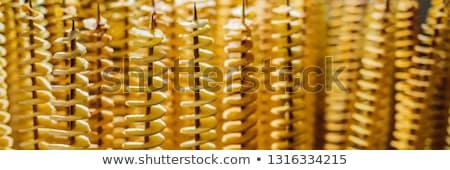 Spirale pommes de terre frit bois alimentaire Photo stock © galitskaya