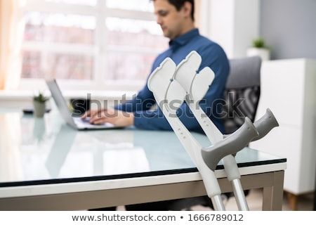 crutches leaning on table in front of handicapped patient stock photo © andreypopov