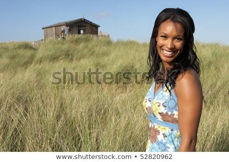 Genç kadın ayakta plaj plaj kulübe mesafe adam Stok fotoğraf © monkey_business