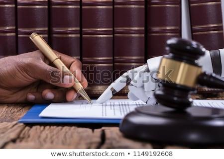 Robotachtige hand persoon ondertekening document Stockfoto © AndreyPopov