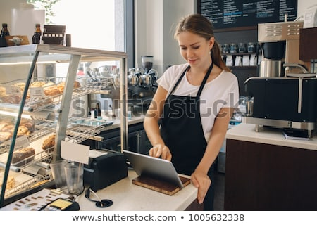 Young girl cashier Stock photo © jossdiim
