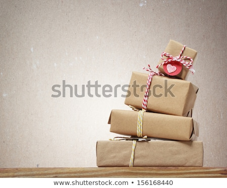 Stack of handcraft gift boxes on wooden board with a natural tex Stock photo © dashapetrenko