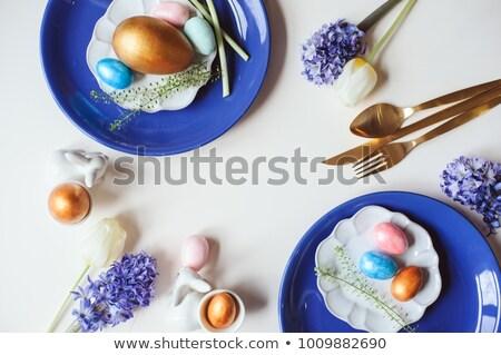 Huevo de Pascua placas cubiertos tulipán flores Pascua Foto stock © dolgachov