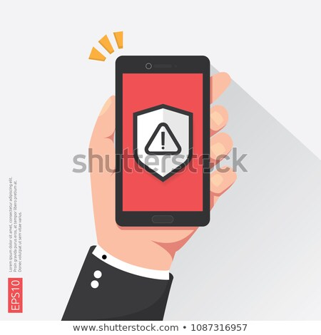 hand holding phone with attention warning alert sign with exclamation mark symbol on screen. shield  Stock photo © taufik_al_amin