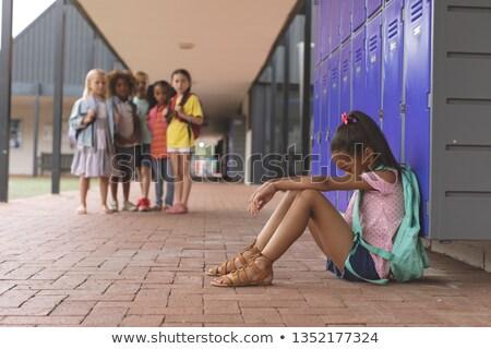 Oldalnézet iskolás lány ül egyedül iskola folyosó Stock fotó © wavebreak_media