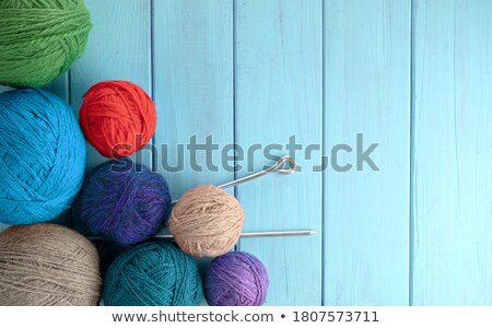 Banner of Knitting. Group of yarn and needles on grey wooden table. Stock photo © Illia