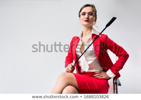 Arrogante mujer de negocios látigo silla oficina traje Foto stock © Kzenon