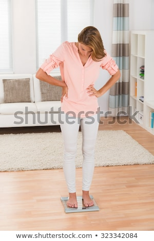 Woman Stand on Scales and Weigh, Lady on Diet Stock photo © robuart