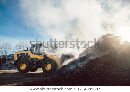 Bulldozer at heavy earthworks in biomass facility  Stock photo © Kzenon