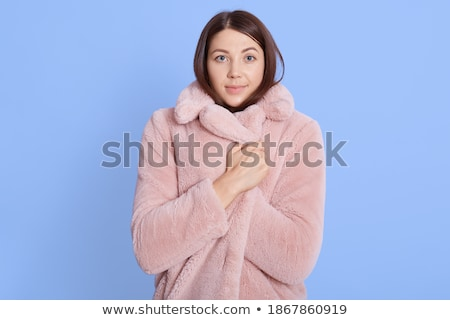 Frozen young woman posing isolated Stock photo © deandrobot