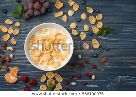 corn flakes with berries on wooden table stock photo © francesco83