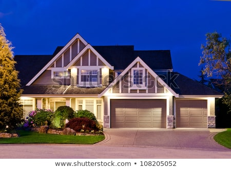 Stock photo: Triple Garage On A House