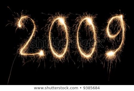 2009 yılbaşı numara havai fişek ışık turuncu Stok fotoğraf © Paha_L