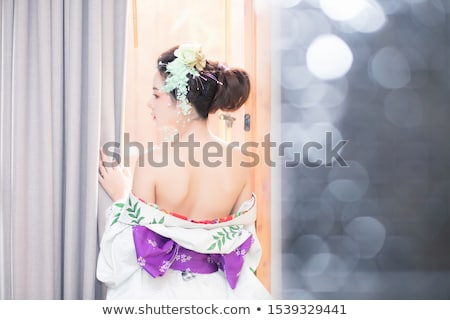Undressing girl in pink  Stock photo © pekour