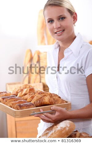 Young female baker with croissants and pain au chocolats Stock photo © photography33