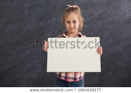 young child holding blank grey cardboard Stock photo © gewoldi