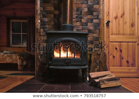 Stockfoto: The Traditional Iron Door To The Tile Stove