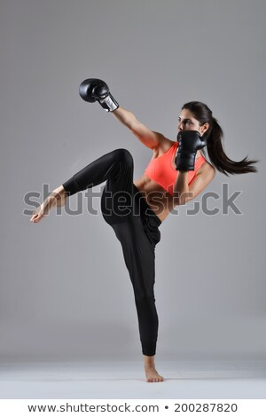 Beautiful female fighter Stock photo © stryjek