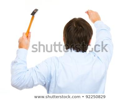 Laborer using hammer on white background Stock photo © photography33