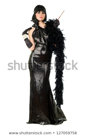 brunette in black dress with cigarette holder stock photo © dolgachov