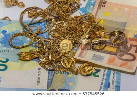 hand golding euro stock photo © shutswis