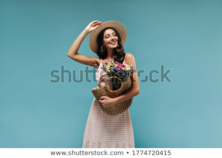 Fashionable girl in modern dress posing. Studio shot Stock photo © gromovataya