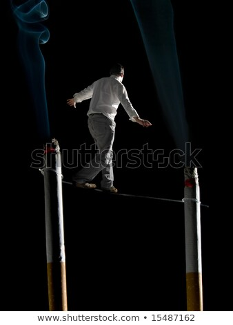 Stock photo: Walking the tightrope of smoking addiction