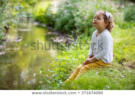 Little girl playing at a riverside Stock photo © photography33