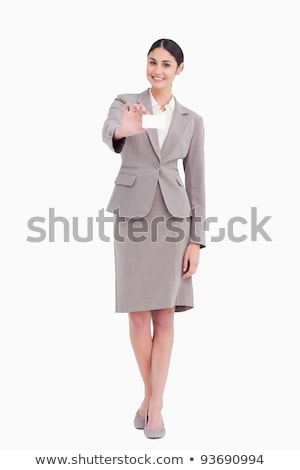 Smiling saleswoman showing blank business card against a white background stock photo © wavebreak_media