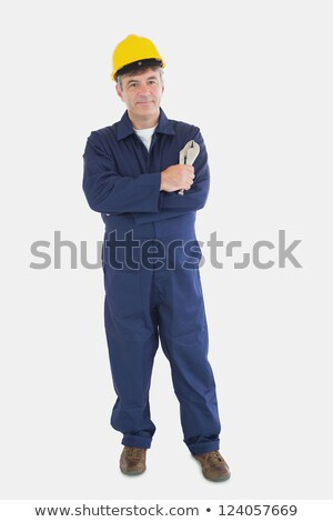portret · glimlachend · mannelijke · uniform · veiligheidshelm - stockfoto © wavebreak_media