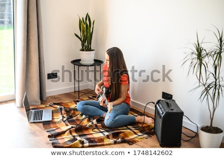 Female guitarist sitting with an amp Stock photo © photography33