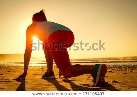 Kadın poz deniz yukarı duvar Stok fotoğraf © ArenaCreative