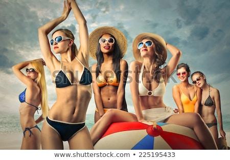 bella · pallone · da · spiaggia · donna · sorridente · occhiali · da · sole - foto d'archivio © dolgachov