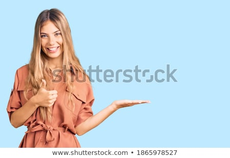 Glimlachende vrouw modieus gebaar geïsoleerd Stockfoto © stepstock