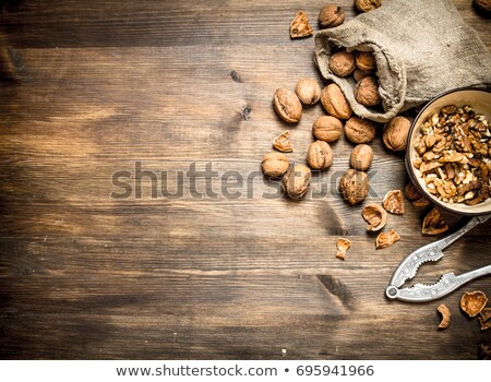 bowl of walnuts and nutcracker stock photo © m-studio