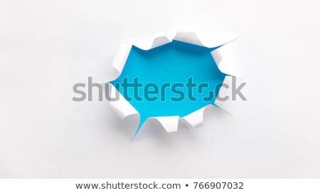 Przełom papieru otwór niebieski wewnątrz ramki Zdjęcia stock © Grazvydas