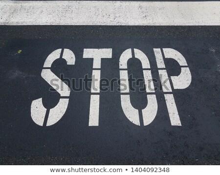 stop painted on asphalt outdoor  Stock photo © juniart