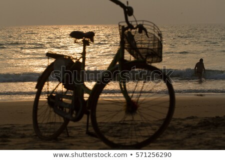 スイマー 銀 光 日没 ビーチ カリフォルニア ストックフォト © meinzahn