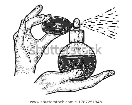 woman hands spraying perfume stock photo © dolgachov