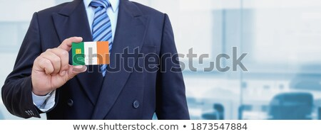 Irish Businessman holding business card with Ireland Flag Stock photo © stevanovicigor