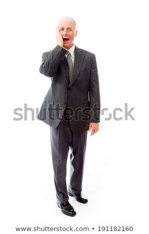 Businessman day dreaming with hand on cheek Stock photo © bmonteny