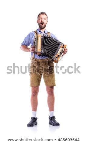 Férfi játszik harmonika ül piros öreg Stock fotó © papa1266