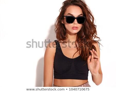 seductive woman wearing sunglasses stock photo © photosebia