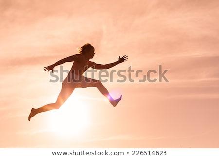 прыжок вперед успех бизнеса бизнесмен длинные ноги Сток-фото © Lightsource