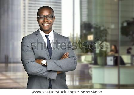 молодые · бизнесмен · оружия · сложенный · глядя · белый - Сток-фото © deandrobot