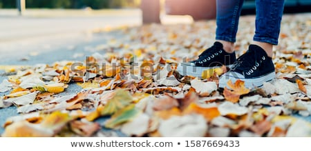 Side view portrait of a woman`s body part in jeans  Stock photo © deandrobot