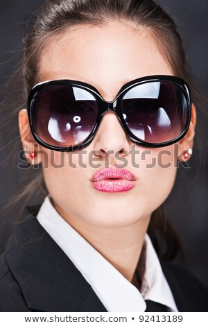 businesswoman sending big kiss stock photo © diego_cervo