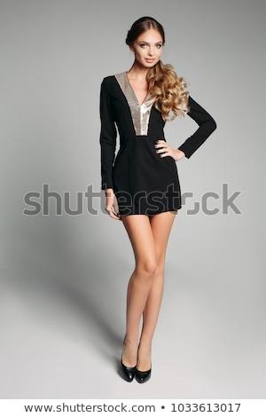 Csinos lány fekete mini ruha izolált Stock fotó © Elnur
